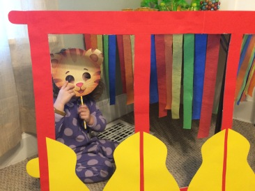 Taking pics in her Daniel Tiger trolley