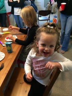 Cupcake decorating. She destroyed that cupcake.