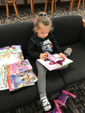 Went to the library on my morning off (because that's what you do...go back to work when you're supposed to be off, right?). She kicked off her shoes and started reading. My heart was happy.